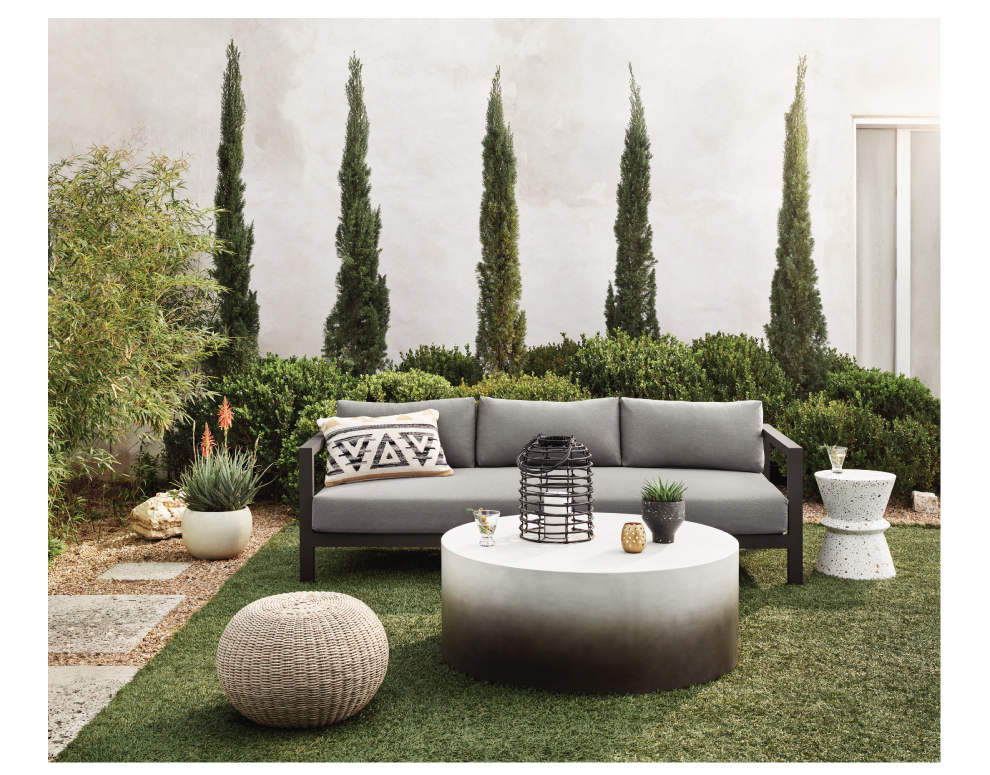 outdoor sofa and woven table and concrete coffee table