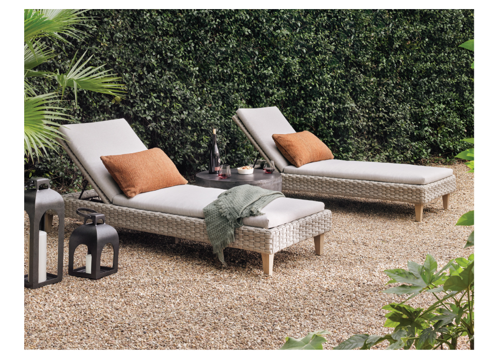 woven outdoor loungers with pillows