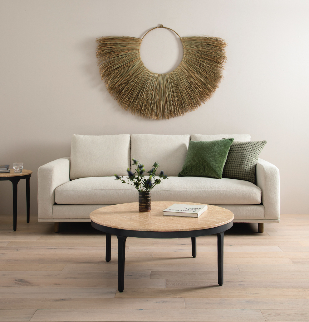 Comfort + Style, Plush Couch with Mixed Materials and Wall Hanging Bohemian Palm Fan