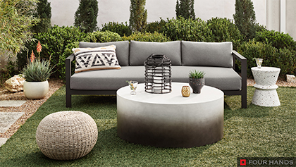 Outdoor Living Area with Woven Texture and Concrete Coffee Table and Terrazzo Accent Side Table