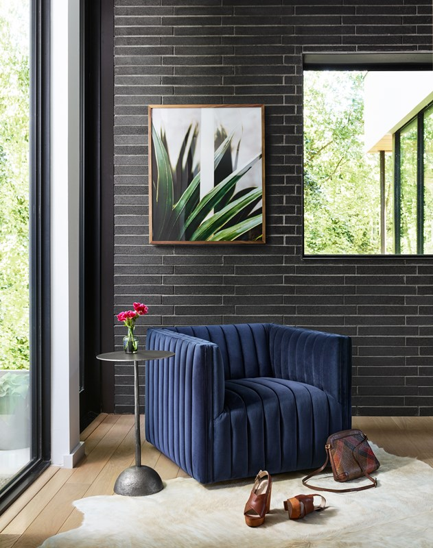 Augustine navy swivel chair, upholstered seating, Adela iron end table, reading nook, modern artwork, Jess Engle, Modern Botanical, Four Hands furniture