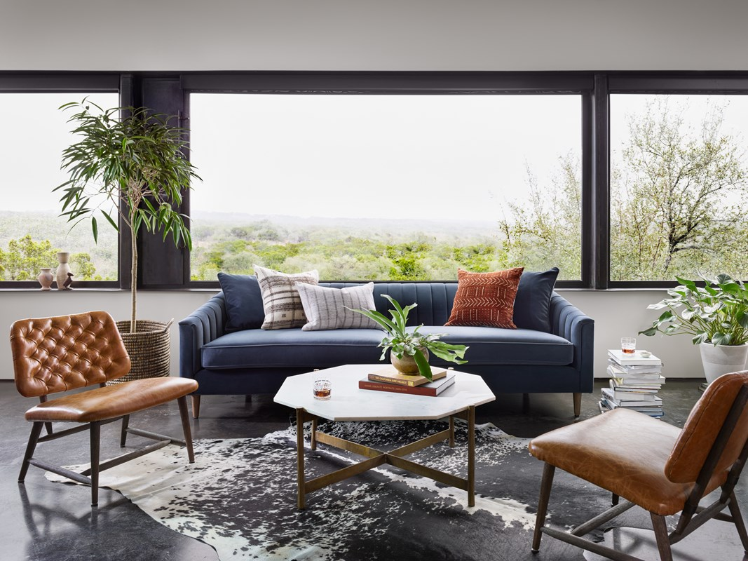 Eve Navy Channeled Polyester Sofa, Adair Octagonal Marble Brass Coffee Table, Nico Tan Tufted Top-Grain Leather Chairs, Modern Living Room, Mid-Century Modern, Four Hands Furniture