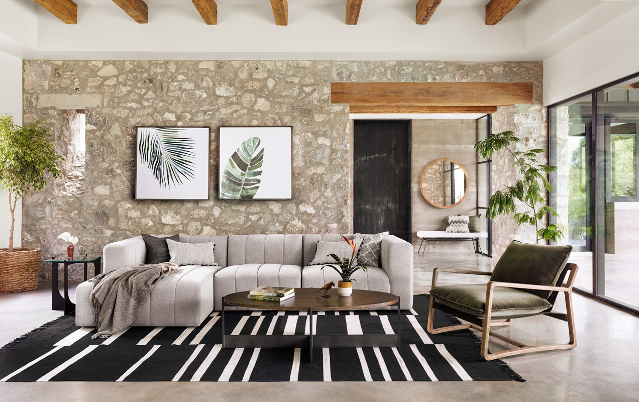 Langham channeled sectional with chaise, olive green upholstered Ace chair, Shannon oval coffee table, Modern Botanical art, Jess Engle art, modern art work, Hildon end table, four hands furniture, modern living room, mid-century style