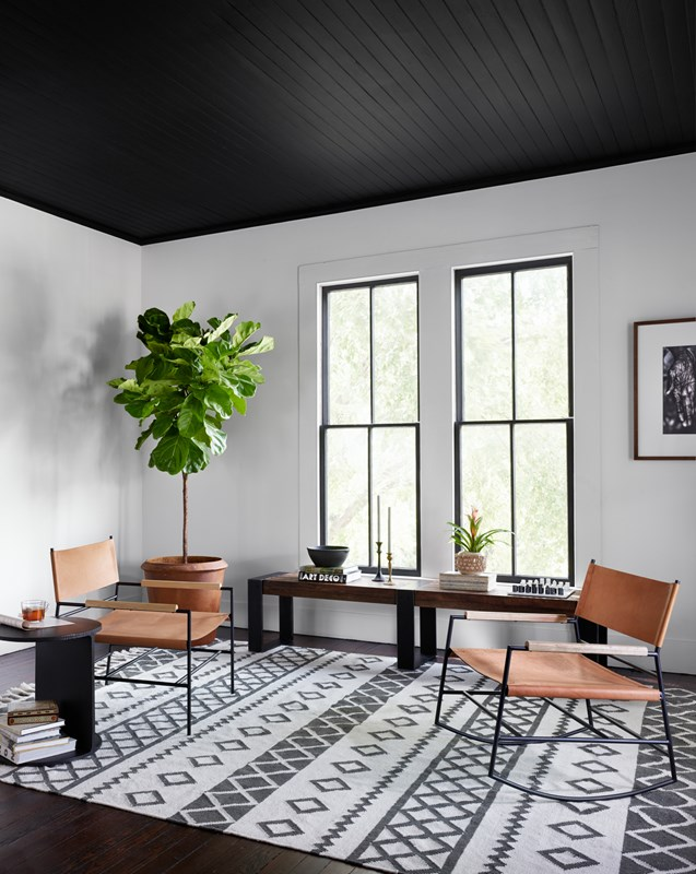 Jack Chestnut Brown Top-Grain Leather Rocker, Warren Peroba Metal Bench, Black and White Diamond Pattern Wool Rug, Modern Sitting Area, Four Hands Furniture