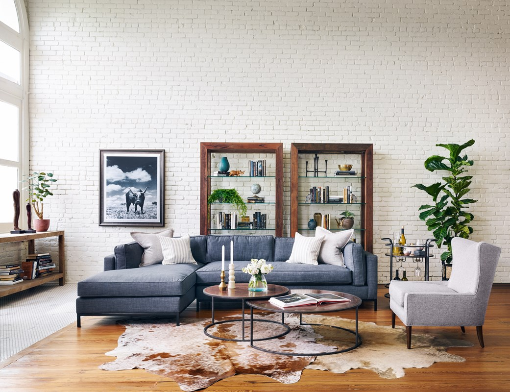 From Left to Right: Lamar Console Table, Grammercy Sectional, Kendrick Tall Bookcase, Catalina Nesting Coffee Table, Eva Bar Cart, Marlow Wing Chair.