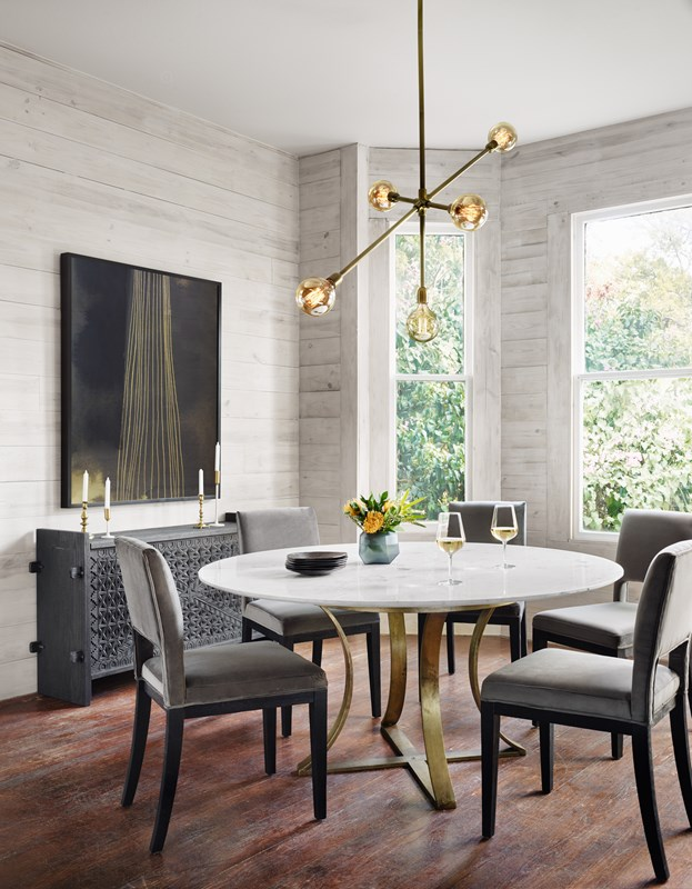 From Left to Right: Ore by Jess Engle, Columbus Trunk Console, Sara Dining Chair, Gage Dining Table, Thalia Chandelier.