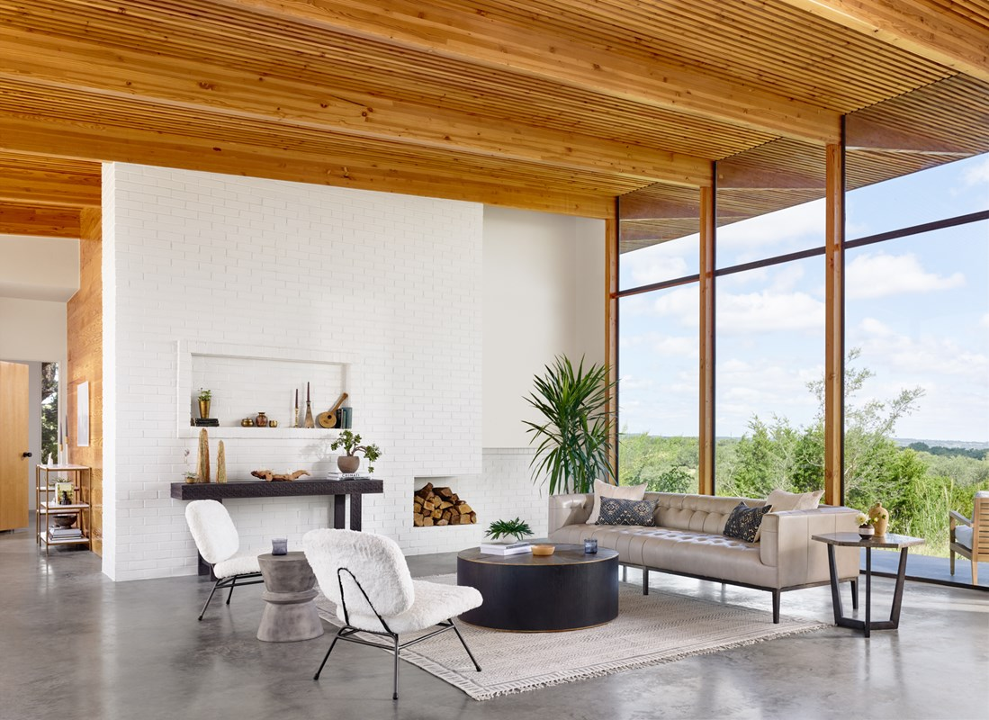 Marlin Stone Top-Grain Leather Tufted Sofa, Perry Brown Oak Round Coffee Table, Caleb White Shearling Chair, Lina Concrete Hourglass End Table, Quentin Bluestone Hexagon End Table, Industrial Accents, Modern Living Room, Mid-Century Modern, Four Hands Furniture