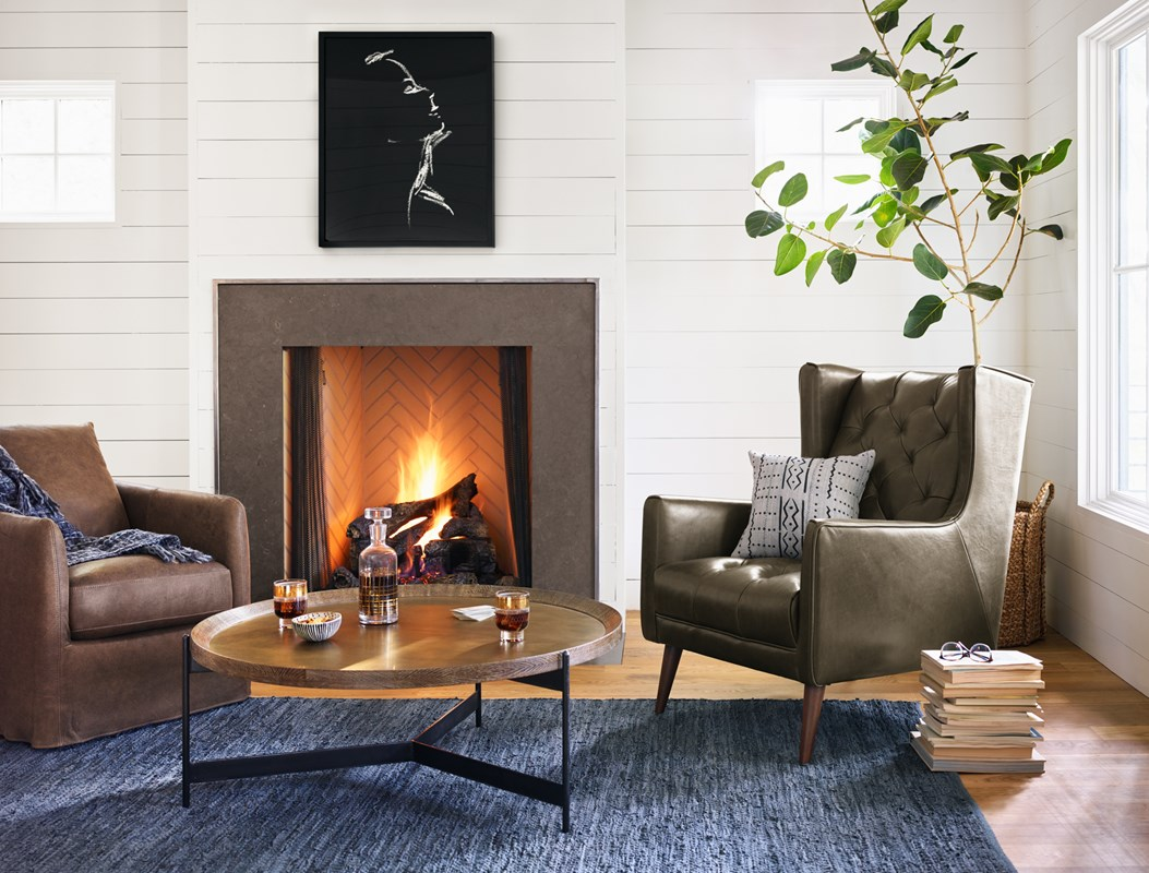 From Left to Right: Banks Swivel Chair, Woven Leather Slate Blue Rug, Eventide, Nathaniel Coffee Table, Barry Chair.