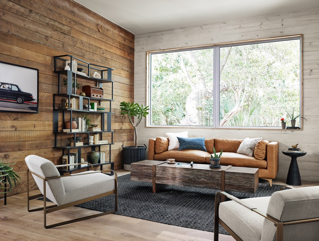 Beckwith Tan Top-Grain Leather Sofa, Mila Walnut Coffee Table, Marlow Bronze Mod Pedestal End Table, Jules Linen Upholstered Arm Chair, Louisa Iron and Oak Staggered Bookshelf, Car Art, Vintage BMW Art, Modern Living Room, Side Room Style, Rustic Living Room, Four Hands Furniture